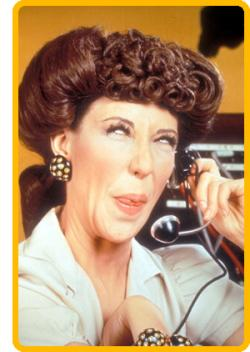 Lily Tomlin as Ernestine, the Telephone Operator