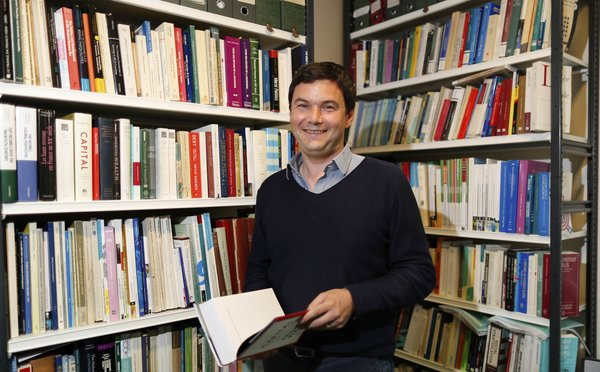 Thomas Piketty in his office at the French School for Advanced Studies in the Social Sciences. Credit Charles Platiau/Reuters