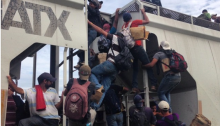Young children boarding La Bestia – The Beast, – the train through southern Mexico