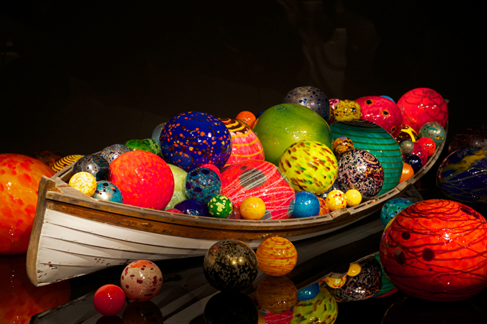 A full-sized canoe filled to overflowing with handblown glass beach balls
