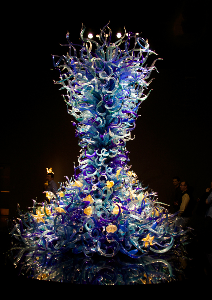 An abstract handblown glass coral reef; note people on right side for scale