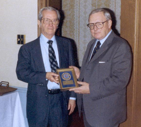 Prof. Fred Inbau, left, receiving an award from Illinois Governor Ogilvie