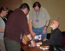 Terry Pratchett signing WC's copy of Wintersmith