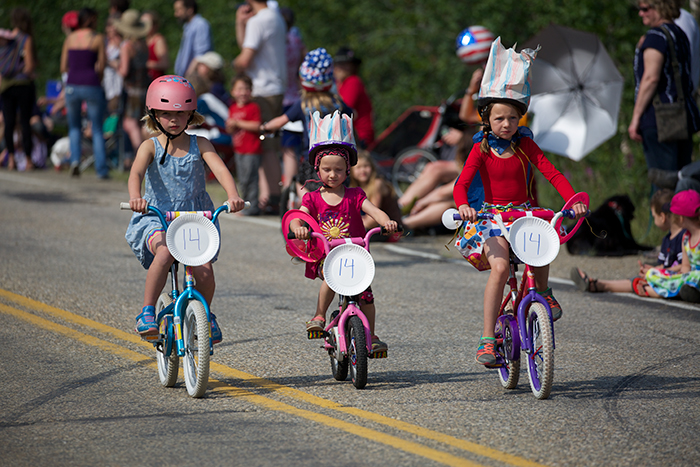Every small town parade has to have little kids on bicycles; it's a rule
