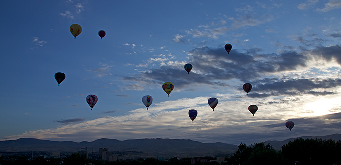 A few of the balloons against a dramatic sky