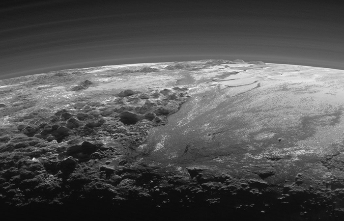 PLUTO'S MOUNTAINS A detail view of the sunset shows rugged mountains up to 11,000 feet high