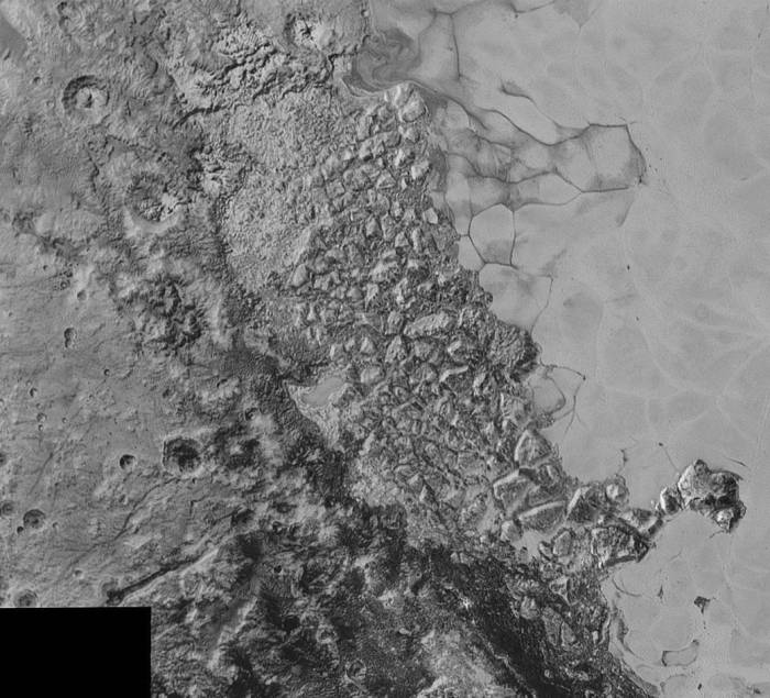 A large region of jumbled, broken terrain on the northwestern edge of the vast, icy plain informally called Sputnik Planum.