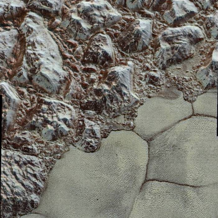 Mountainous shoreline of Sputnik Planum. In this highest-resolution image from NASA's New Horizons spacecraft, great blocks of Pluto's water-ice crust appear jammed together in the informally named al-Idrisi mountains.