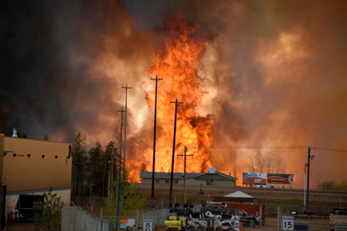 A wildfire on May 3 forced the evacuation of the city of Fort McMurray in the heart of Alberta's oil sands region. Credit CBCNews, via Reuters