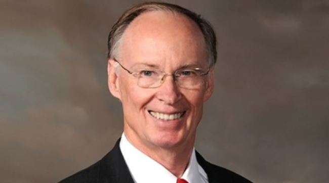 Alabama Governor Robert J. Bentley (and one weird looking dude), explaining he didn't have sex with that woman