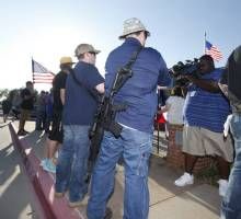 Open carry supporters attended a counterprotest in front of the McKinney Police Department in June 2015. Photo credit: Dallas Morning News