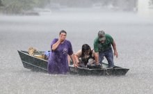 Dee Vazquez, from left, helped Georgette Centelo and her grandfather Lawrence Roberts in Central, north of Baton Rouge, La., on Monday. Credit David Grunfeld/The Times-Picayune, via Associated Press