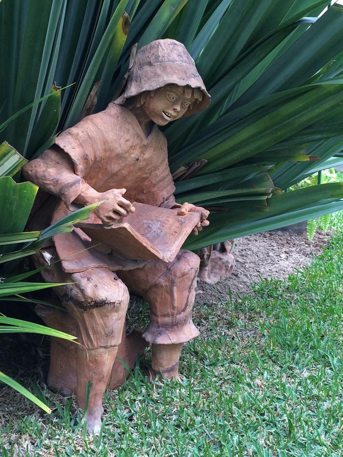 A Really Compelling Book; garden statue, Hotel Señorial, Miraflores, Peru