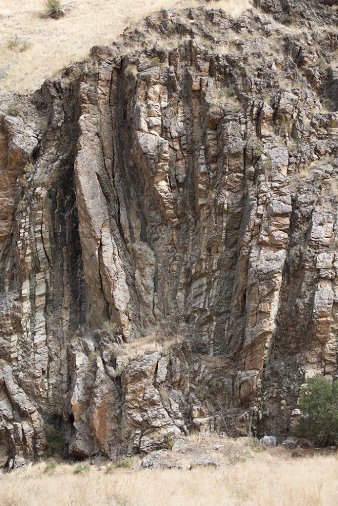 Layers of ash, basalt and limestone from one of the ancient volcanic islands, metamorphonzed and turn on end. Photo at Kirkland Ranch, Hells Canyon.