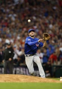 MVP Kris Bryant of the Chicago Cubs throws to first for the final out in of Game 7 of the 2016 World Series