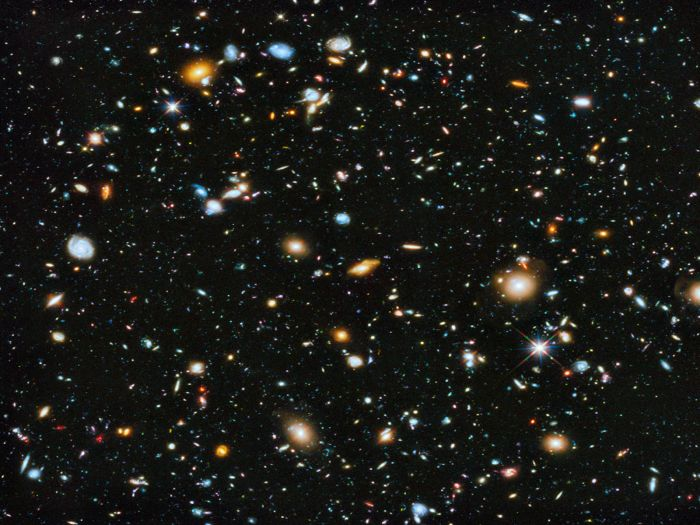 Hubble Space Telescope photographs a small portion of a large galaxy census called the Great Observatories Origins Deep Survey