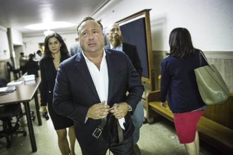 """Infowars"" host Alex Jones arrives at the Travis County Courthouse in Austin, Texas, on April 17. Tamir Kalifa / American-Statesman via AP"