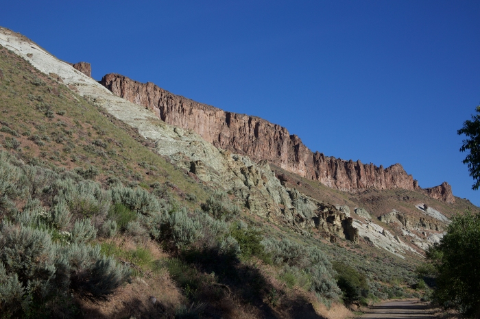 Basalt cap rock on rim of Mahogany Mountain caldera; gray-colored ash flow in foreground