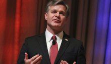 Wray speaks at the International Association of Chiefs of Police annual conference Sunday, Oct. 22, 2017, in Philadelphia. (AP Photo/Michael Balsamo)