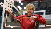 Wasilla head coach Jeannie Hebert-Truax waves the net after cutting it down as the Warriors celebrated their second-straight 4A girls state championship in 2017. Hebert-Truax, who has led Wasilla to six state titles, has been named a head coach for the McDonald's All-American Game. Photo credit: Jeremiah Bartz/Frontiersman