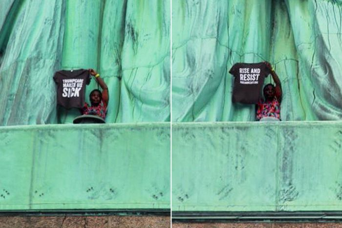 """Therese Okoumou climbed onto the base of the Statue of LIberty on the 4th of July and held a T-shirt with """"Trumpcare Makes Us Sick"""" on one side and """"Rise and Resist"""" on the other. (Courtesy Miranda Nunez Moreno)"""