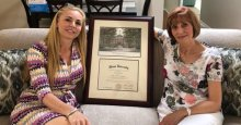 Melissa Howard posing with he mother and her forged diploma. Mom must be awfully proud.
