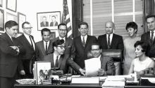 Photo shows Alaskans who traveled to Washington, D.C., for congressional hearings on the Alaska Native Claims Settlement Act, which was signed into law by President Richard Nixon in December 1971. Standing from left are George Cardner, Roger Connor, Emil Notti, Flore Lekanof, Cliff Groh, Barry Jackson, congressional secretary Thoda Forslund and Morris Thompson. Seated are Alaska state Rep. Willie Hensley, Alaska U.S. Rep. Howard Pollock and Laura Bergt. (ADN archive; Anchorage Times photo)