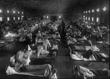 Influenza victims crowd into an emergency hospital near Fort Riley, Kansas in this 1918 file photo (AP Photo/National Museum of Health)