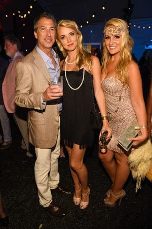 Marc Leder, left, and guests attend a 2015 benefit in the Hamptons. (Scott Roth/Invision/AP)