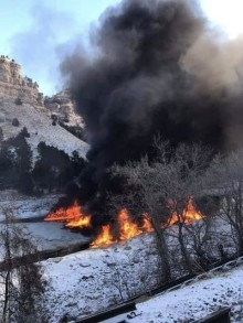 Travis Schumm/ Courtesy The Platte River is set on fire following train derailment.