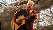 John Prine performing at the Bonnaroo Music and Arts Festival in Manchester, Tenn. Prine, 2019 (Photo by Amy Harris/Invision/AP)