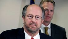 Alaska Attorney General Kevin Clarkson, left, is seen at a press conference Thursday, Sept. 26, 2019, in Anchorage, Alaska. (AP Photo/Mark Thiessen)
